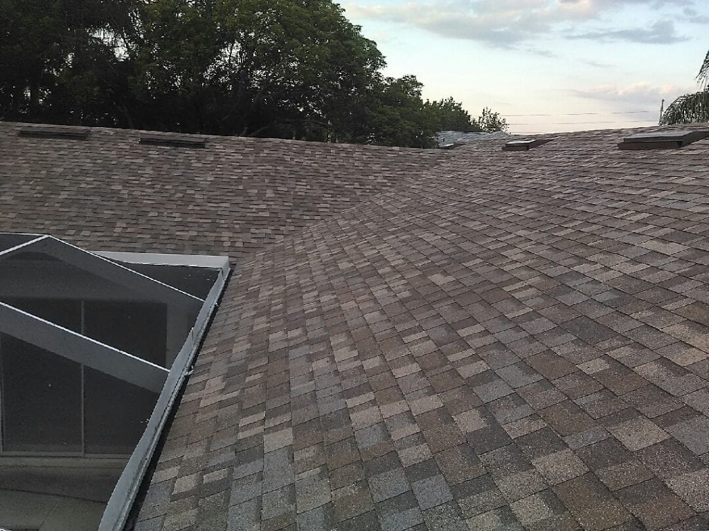 The Disadvantages of Installing New Shingles Over Old Shingles